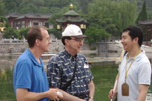 "Wu ""Harry"" Tao (right) talks with St. Bonaventure professors Carl Case (left) and Darwin King at the Winter Palace in Xi'an."