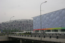 The Birds Nest (left) and the Water Cube stand side-by-side in Beijing's Olympic Village.