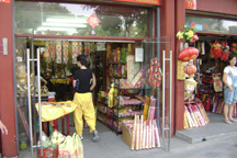 From multinational corporations to small shops like this one in Beijing near the Lama Temple to individual street vendors, capitalism is alive and well in China.