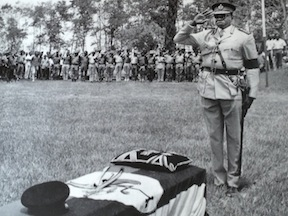 Amin salutes the body of the Bugangan king, which he had returned from exile for burial--a move that made Amin widely popular among many of his countrymen.