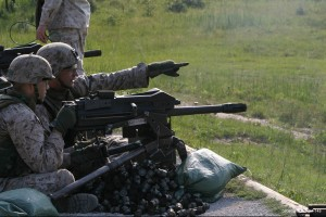 U.S. Marines fire an MK19-3 40 mm grenade machine gun at Range K-211 during weapons training in Marine Corps Base Camp Lejeune, N.C., June 6, 2008. The Marines are assigned to Charlie Company, Infantry Training Battalion, School of Infantry-East. (U.S. Marine Corps photo by Pfc. Maxton G. Musselman/Released)