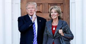Donald Trump and Betsy DeVos (image credit: Slate)
