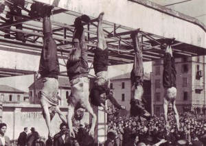 The corpse of Mussolini (second from left) next to Petacci (middle) and other executed fascists in Piazzale Loreto, Milan, 1945